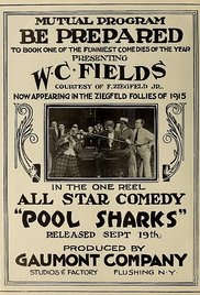 Pool Sharks poster with W.C. Fields sitting on pool table surrounded by a crowd of people.